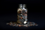 Loose Coins Stored in a Glass Money Jar 38881