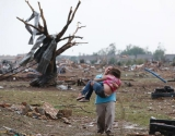 Entire neighborhoods were flattened, broken families and loved ones lost in the chaos of wind scattered debris. 41170