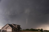 A tornado is made near a house in South Haven, Kansas, as big funnel cloud churning through the water 41182