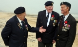 Several hundred British and American veterans of the 1944 landings gather to pay their respects 44440