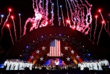 Fireworks burst over the Hatch Shell during the finale of the Boston Pops Fourth of July Concert in Boston. 44949