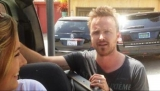 Breaking Bad' star Aaron Paul greets Irish tourists outside his LA home 45580