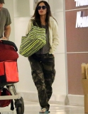 Megan Fox tries to keep her baby bump hidden as she makes her debut after confirming second pregnancy 45694