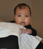 What a cutie! Kanye West reveals first picture of his and Kim Kardashian's baby daughter North on granny Kris's chat show 46230