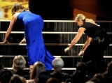 Tina Fey and Amy Poehler trip up the stairs at the Emmys in a comedy tribute to Jennifer Lawrence who stacked it at the Oscars 46640