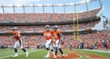 Manning sets record with four more touchdown passes 46923