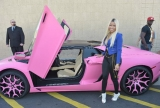 Nicki Minaj rolls up to her Kmart clothing line launch in a pink Lamborghini Aventador 47414