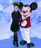 Andy who? Made In Chelsea's Louise Thompson branches out from her usual SW3 dating zone as she cuddles up to Mickey Mouse at Disneyland 48037