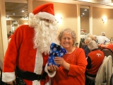 Santa Claus giving gifts, taking pictures with old woman 48626
