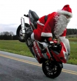 Santa riding a machine 48627