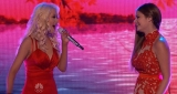 Ladies in red! Christina Aguilera and The Voice contestant Jacquie Lee are glamorous in coordinating scarlet dresses as three finalists duet with their coaches 48834